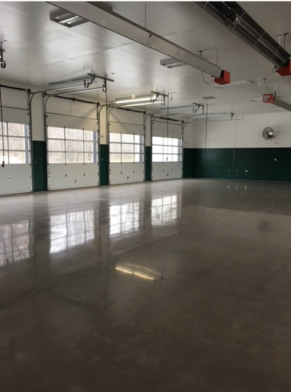 A brown polished concrete floor in a garage.