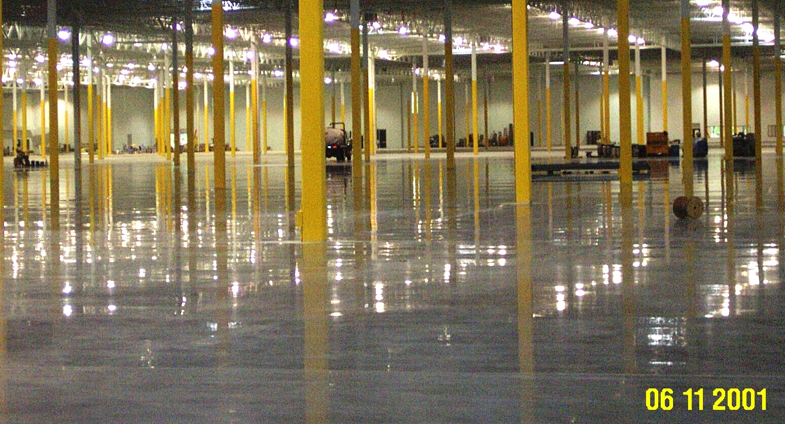 Yellow columns rise from a polished concrete floor in a Volkswagen parts warehouse in WI.
