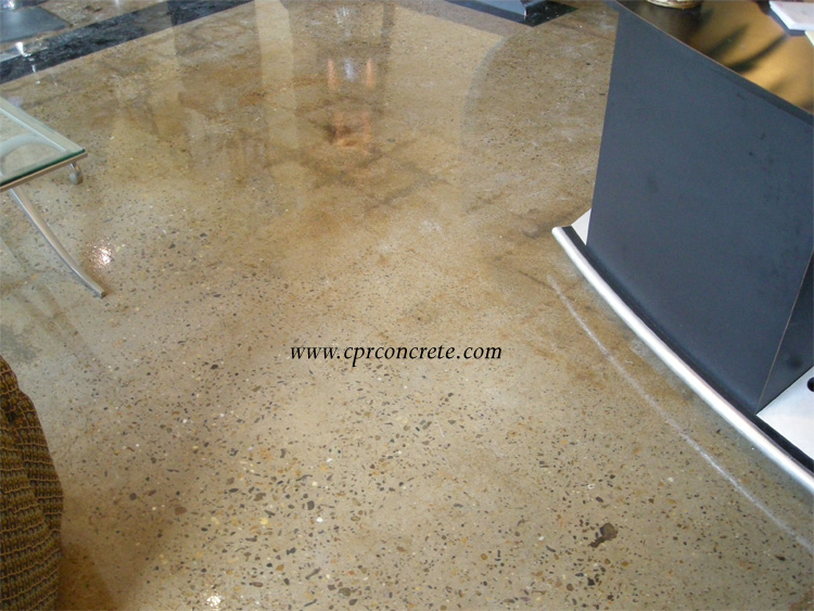 A beautiful, tan-colored, polished cement floor adorns a hair salon.