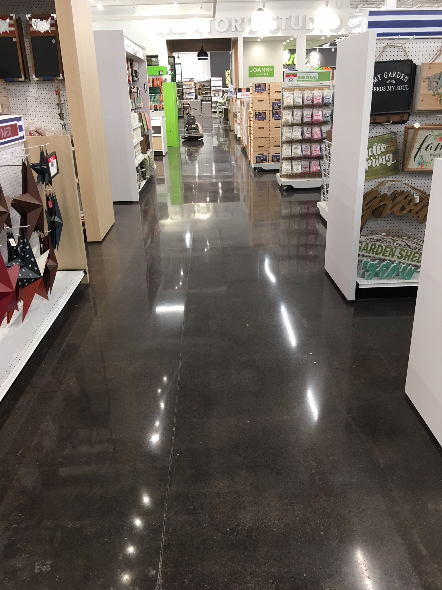 A polished concrete aisle in a store.