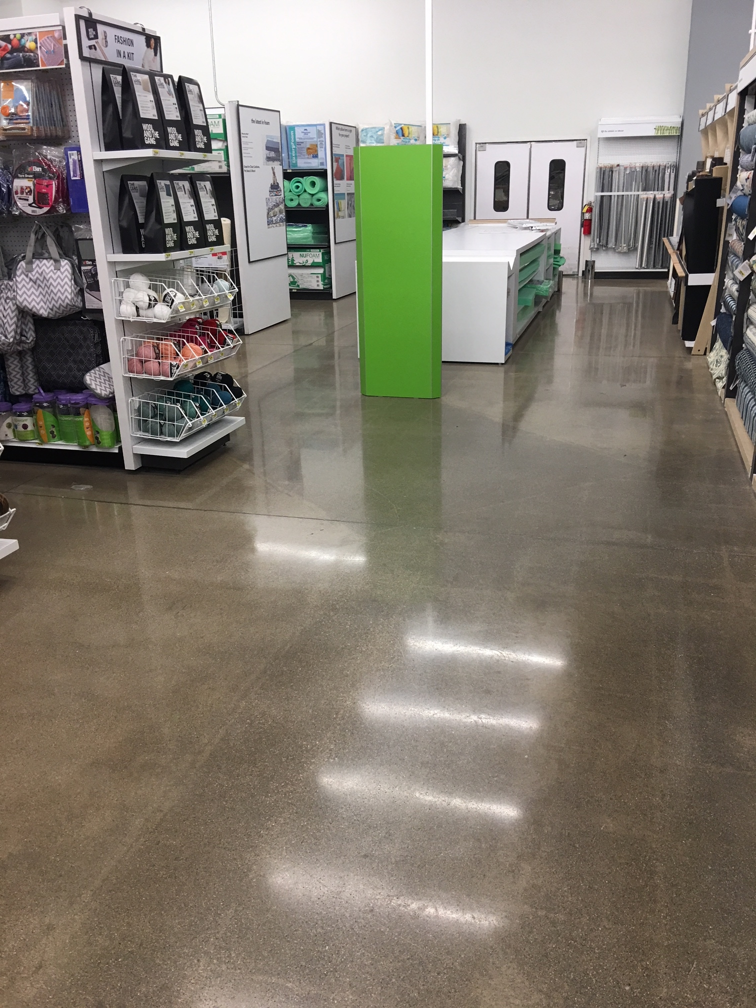 A brown polished concrete floor in a store.