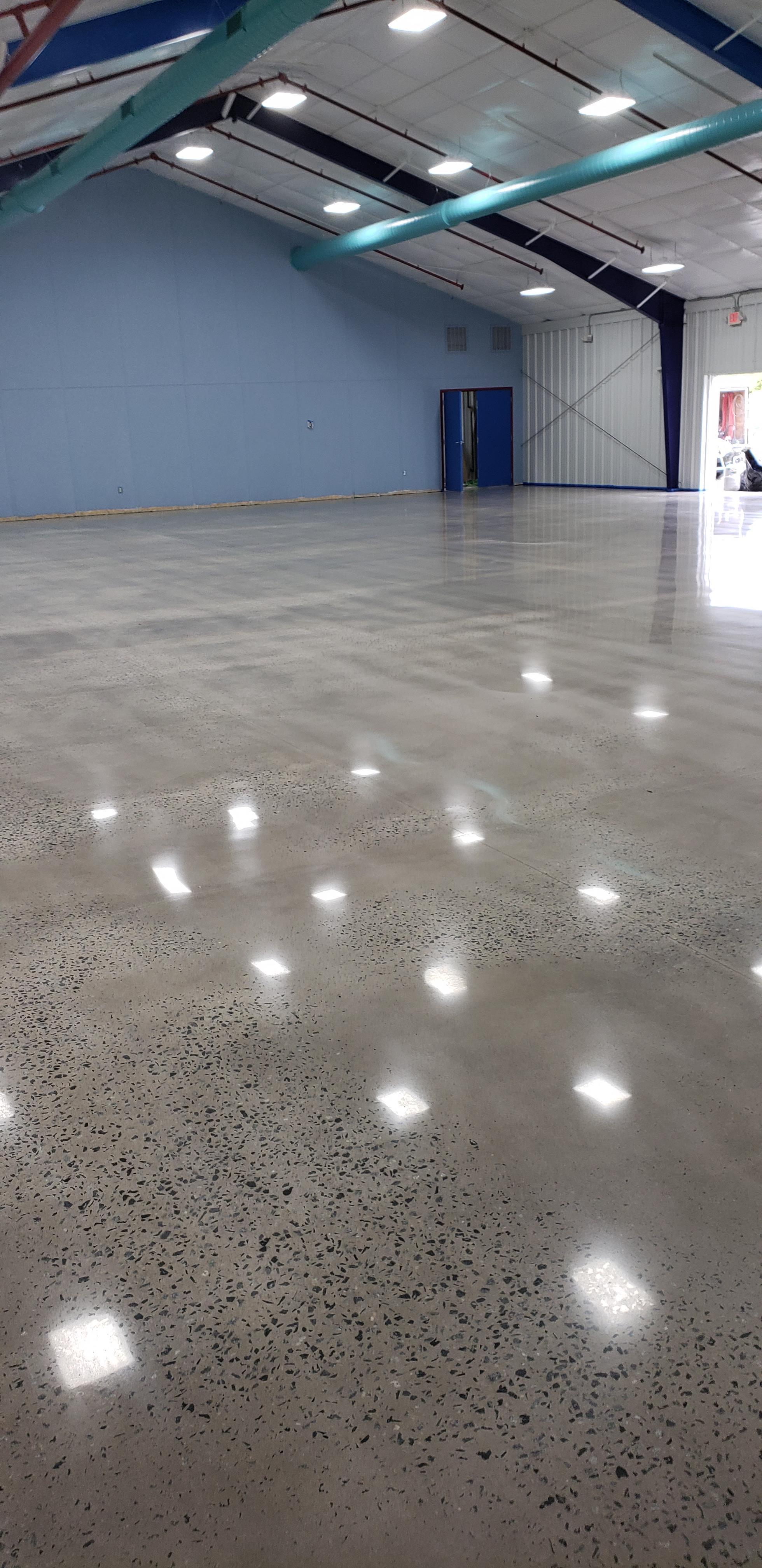 A gray polished concrete floor in an indoor archary range.